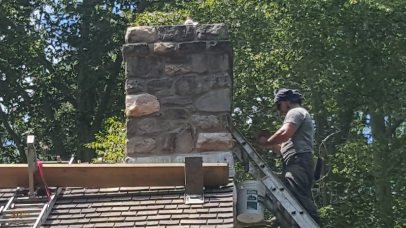 Affordable Mason pointing and repairing chimney